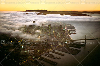 Dowtown San Francisco Skyline with Transamerica Pyramid at dusk with Fog. California.