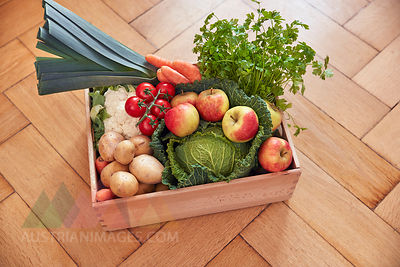 Box with produce on parquet floor