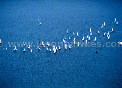 Sailing boats ( Lasers )  in race, UK.