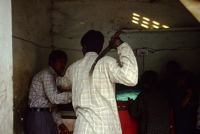 India - New Delhi - A fight between two men over gambling
