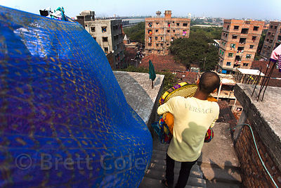 A family does laundry on the roof of an apartment in the Fakir Bagan area of Howrah, India, sister city to Kolkata.