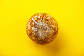 Coconut Water in natural coconut healthy drink on yellow background