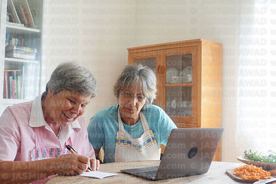 Senior ladies looking for a recipe online