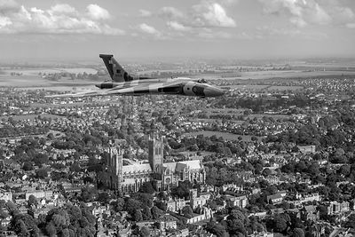 Avro Vulcan passing Lincoln Cathedral B&W version
