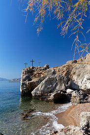 Three crosses on rocks beside sea south of Stegna, Archangelos, Rhodes, Dodecanese Islands, Greece.