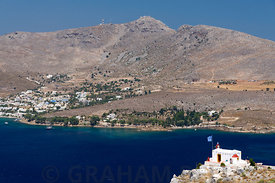 Alinta and Alinta Bay with Profitis Ilias church in the foreground, Leros, Dodecanese Islands, Greece.