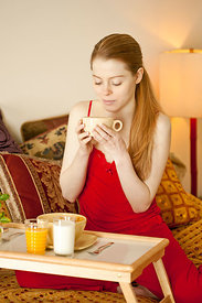 woman having breakfast in bed