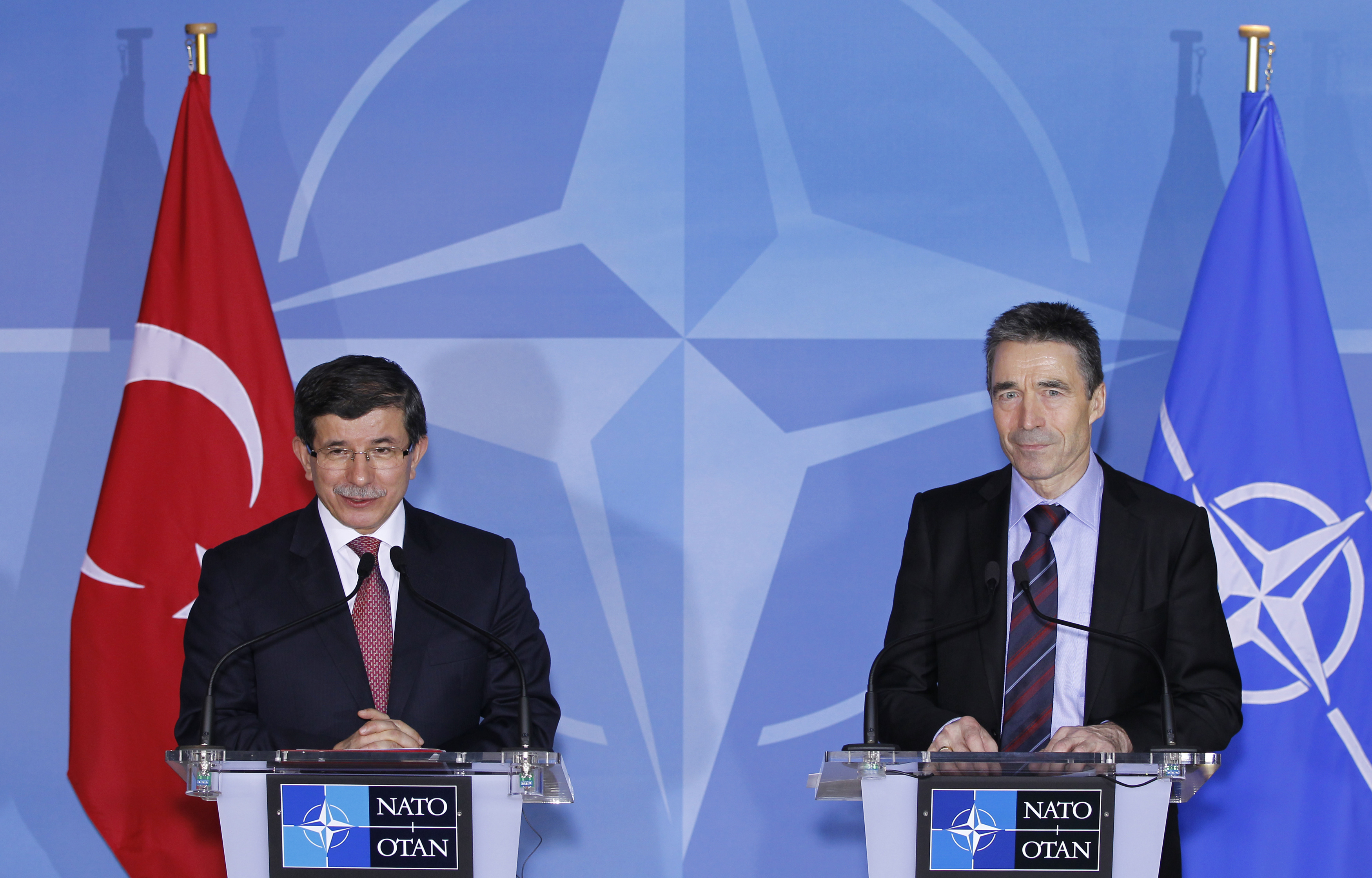 NATO Secretary General Anders Fogh Rasmussen and Turkey's Foreign Minister Ahmet Davutoglu (L) address a joint news conference after their meeting at the Alliance's headquarters in Brussels January 18, 2012. REUTERS/Francois Lenoir (BELGIUM - Tags: POLITICS MILITARY)