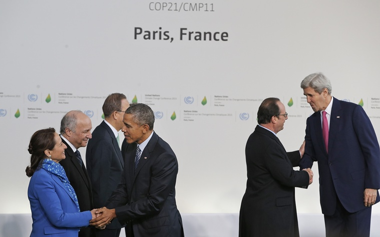 U.S. President Barack Obama, fourth left, is greeted by Segolene Royal, French Minister for Ecology, Sustainable Development and Energy, left, and U.S. Secretary of State John Kerry, right, is greeted by French President Francois Hollande, as they arrive for the COP21, United Nations Climate Change Conference, in Le Bourget, outside Paris, Monday, Nov. 30, 2015. (AP Photo/Christophe Ena, Pool)