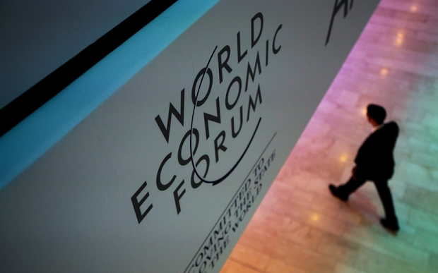 A WEF logo sits on display in a hall inside the Congress Center ahead of the World Economic Forum (WEF) in Davos, Switzerland, on Tuesday, Jan. 19, 2016. World leaders, influential executives, bankers and policy makers attend the 46th annual meeting of the World Economic Forum in Davos from Jan. 20 - 23. Photographer: Jason Alden/Bloomberg