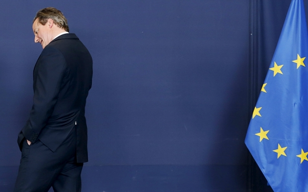 Britain's Prime Minister David Cameron arrives to pose for a family photo during a European Union leaders summit in Brussels April 23, 2015. European Union leaders who decided last year to halt the rescue of migrants trying to cross the Mediterranean will reverse their decision on Thursday at a summit hastily convened after nearly 2,000 people died at sea. REUTERS/Francois Lenoir