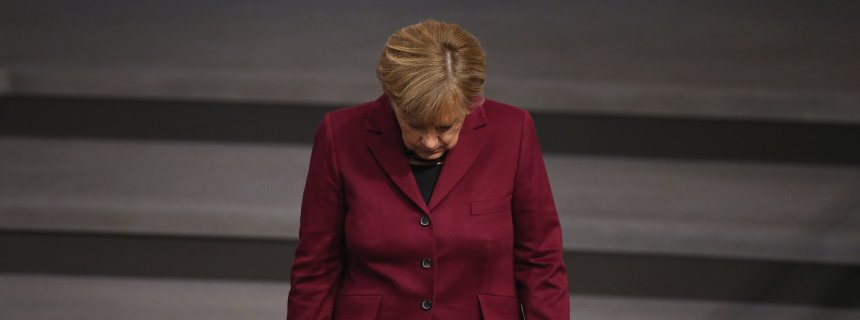 (FILE) +++ NEWS- UND ENTERTAINMENTFOTOS DER WOCHE +++ BERLIN, GERMANY - OCTOBER 15: German Chancellor Angel Merkel walks into the plenary hall at the Bundestag during debates that centered on Germany's refugee policy on October 15, 2015 in Berlin, Germany. Merkel gave a government declaration in which she reiterated her refugee policy stance prior to an upcoming European Union summit in Brussels. The Bundestag also voted later in the day on a new packet of measures to deal with the challenge of accommodating so many migrants and refugees this year. Merkel has coming under increasing pressure, including from members of her own political party, the German Christian Democrats (CDU), from critics who argue Germany is unable to cope with so many newcomers. Germany is expected to receive up to a million or more migrants this year. (Photo by Sean Gallup/Getty Images)