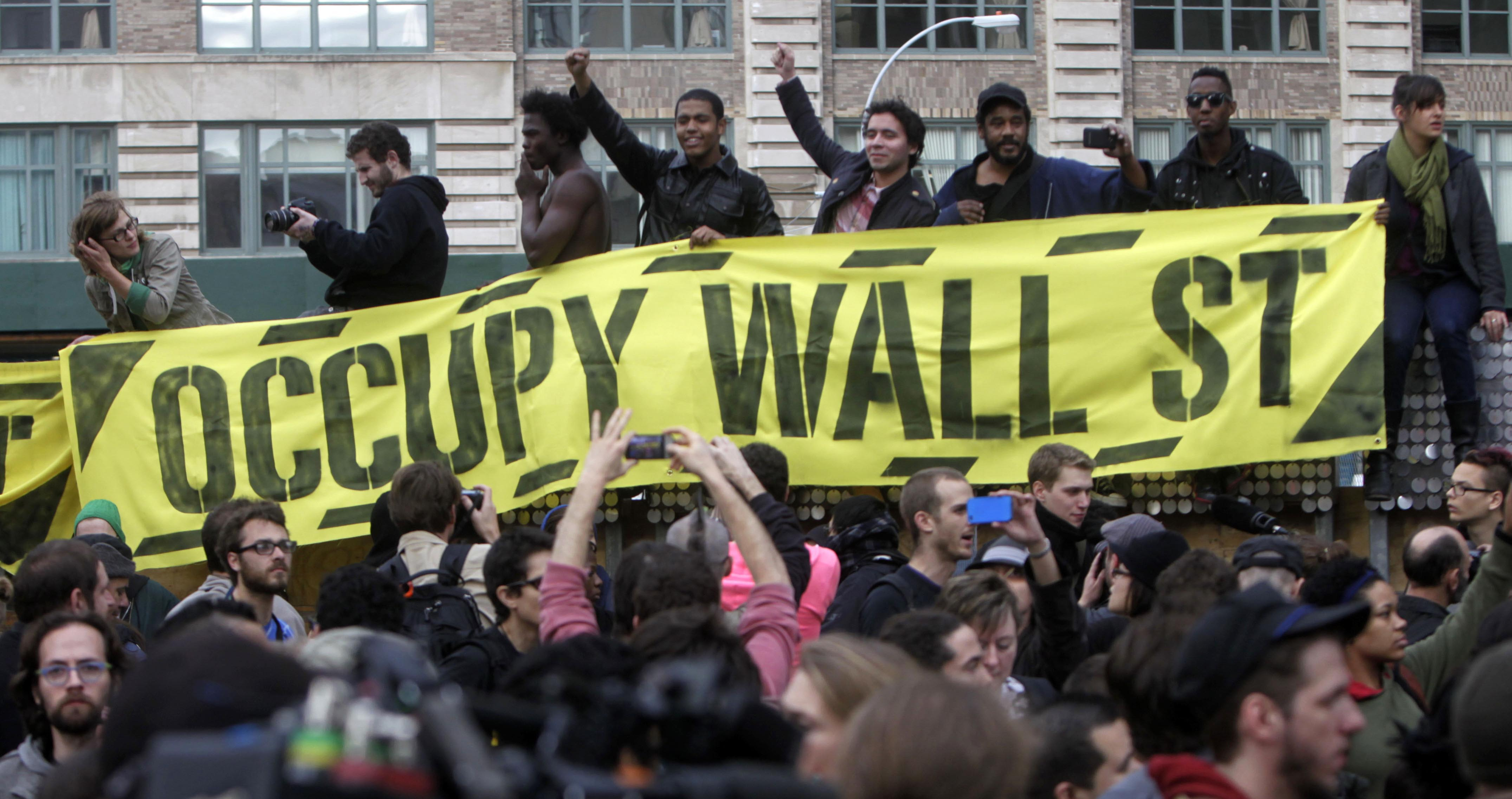 Occupy Wall Street protesters rally in a small park on Canal Street in New York, Tuesday, Nov. 15, 2011. Police officers evicted the protesters from their base in Zuccotti Park overnight. The National Lawyers Guild obtained a court order allowing the protesters to return with their tents to the park, where they have camped for two months. The guild said the injunction prevents the city from enforcing park rules on the protesters. (AP Photo/Seth Wenig)