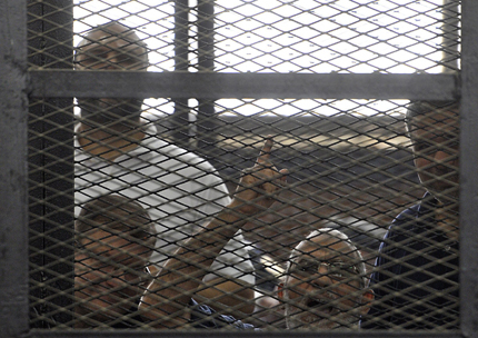 epa04243597 Egypt's Muslim Brotherhood Supreme Guide Mohamed Badie speaks from behind an enclosed dock during a trial session in Cairo, Egypt, 07 June 2014. An Egyptian court handed down preliminary death sentences to 10 Muslim Brotherhood supporters on charges of murder, violence and blocking a road north of Cairo while protesting for Islamist president Mohammed Morsi last year.  EPA/TAHSEEN BAKR EGYPT OUT