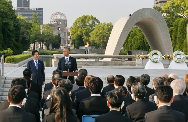 epa05331848 US President Barack Obama (2-L) delivers his speech as Japanese Prime Minister Shinzo Abe (L) listens after laying wreaths in front of a cenotaph to offer a prayer for victims of the atomic bombing in 1945 at Hiroshima Peace Memorial Park with viewing the Atomic Bomb Dome (Rear) in Hiroshima, western Japan, 27 May 2016. Obama visited Hiroshima for the first time as US President after the atomic bombing of Hiroshima City. Obama visited the city after attending the two-day G7 Ise-Shima Summit talk. EPA/KIMIMASA MAYAMA / POOL