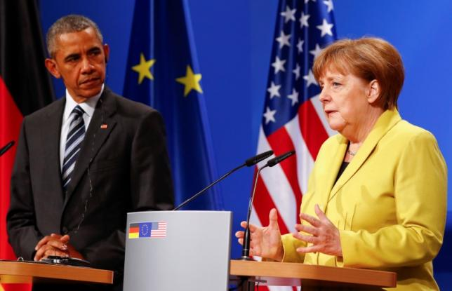 German Chancellor Angela Merkel and U.S. President Barack Obama speak to media during a news conference after their talks at Schloss Herrenhausen in Hanover, Germany April 24, 2016. REUTERS/Kai Pfaffenbach