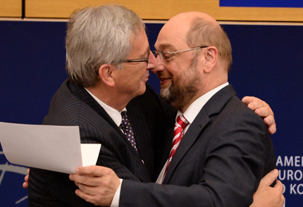 epa04316930 Martin Schulz (R), President of the European Parliament, congratulates Jean-Claude Juncker (L), candidate for President of the Commission, in a press conference after the plenary session in the European Parliament in Strasbourg, France, 16 July and gives him the appointment certificate. EPA/Patrick Seeger