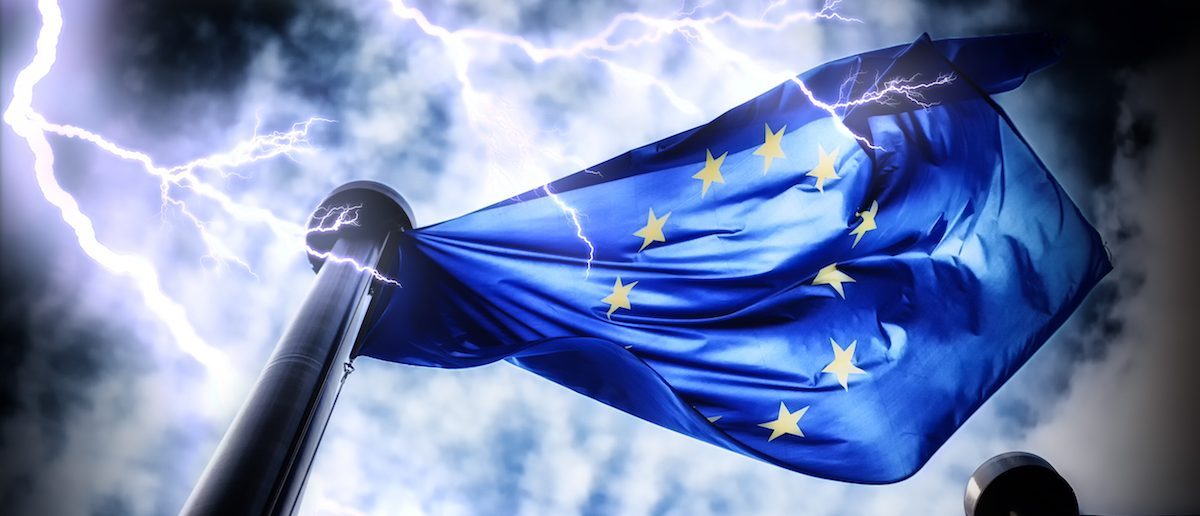 european-union-flag-on-dark-thunderstorm-sky-background-e1465394079567