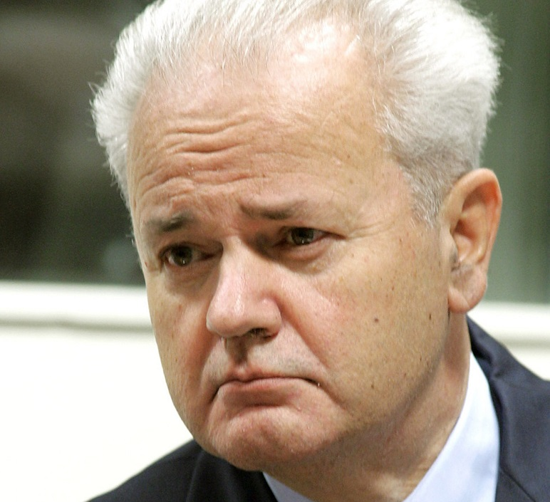 ** FILE ** Former Yugoslav President Slobodan Milosevic enters a court room of the war crimes tribunal in The Hague, Netherlands, in this Aug. 31, 2004 file picutre. Milosevic was found dead in his cell in The Hague on Saturday March 11, 2006, the U.N. tribunal confirmed. (AP Photo/Fred Ernst, Pool)