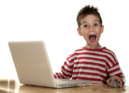 excited child with laptop