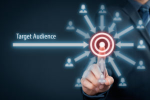 Target audience concept. Businessman click on target audience pointing to target is around target.
