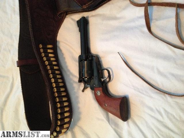 Its stainless and comes with a nice leather holster and belt