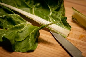 Bo La Lot Vegan recipe cutting Swiss chard leaves