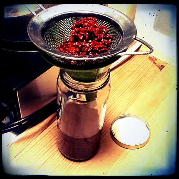 Straining the annatto oil for vegan chorizo