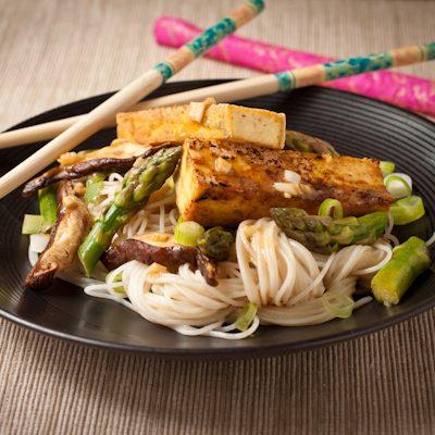Miso-glazed tofu with shiitake mushrooms, asparagus, and rice noodles