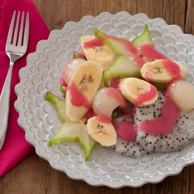 Exotic fresh fruit salad with yogurt sauce