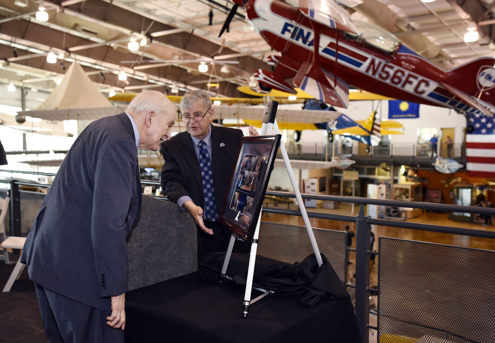 Stephen Holt of the Veterans Administration North Texas Health Care System presented a photo to Rep. Sam Johnson in honor of National Former Prisoner of War Recognition Day on April 20, 2018, at the Frontiers of Flight Museum at Dallas Love Field.