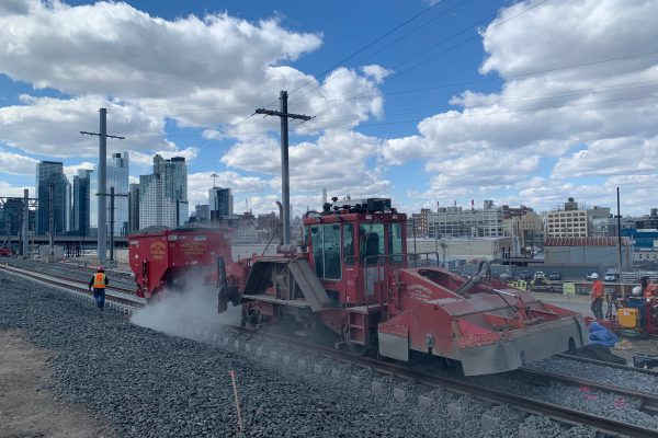 Placing ballast for newly-installed track in Harold Interlocking 03-18-19