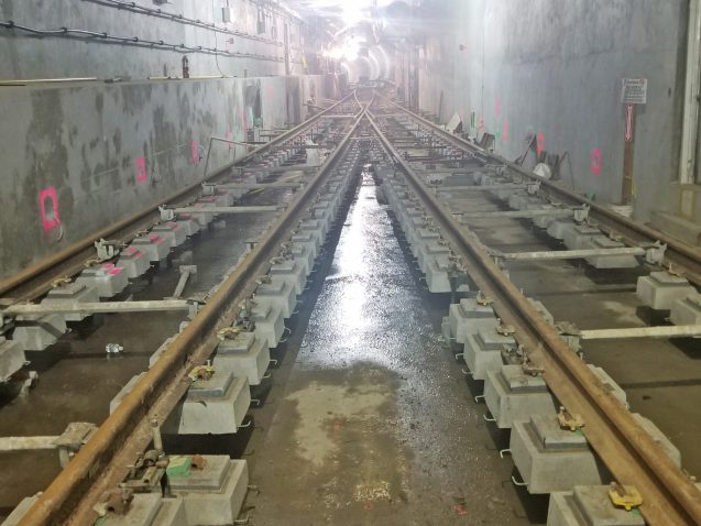 Concrete slab installation under resilient tie block rail. Resilient tie blocks are a new technology 04-19-19