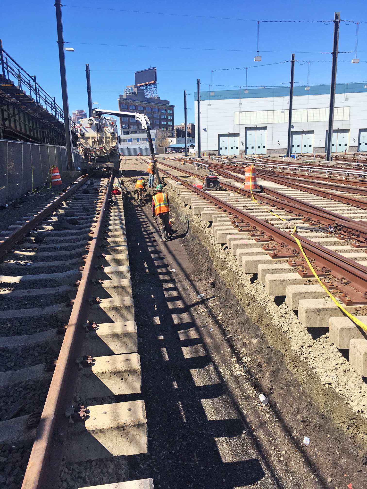 Vacuum track excavation of material between tracks in Mid Day Storage Yard for future conduit installation 04-19-19