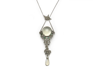 An Art Nouveau Moonstone, Emerald and Marcasite Pendant.