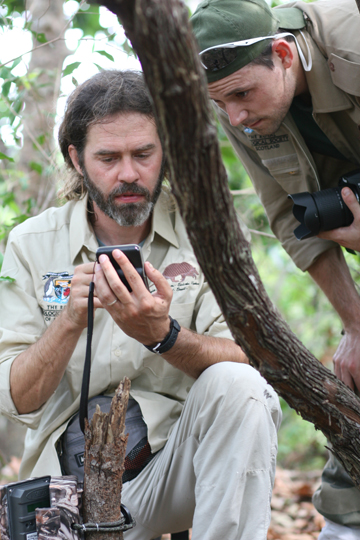 Arnaud Desbiez and Danilo Kluyber looking at camera trap pictures. Photo by: The Pantanal Giant Armadillo Project.