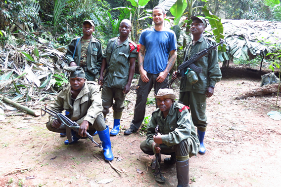 Roger Peet (in blue shirt) posing with Forest Rangers. Photo courtesy of Roger Peet.
