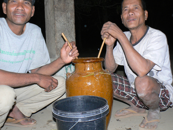 Our guide Jeung (left) and Kohng Ngok 'magic man' June (right). Photo by: Greg McCann.