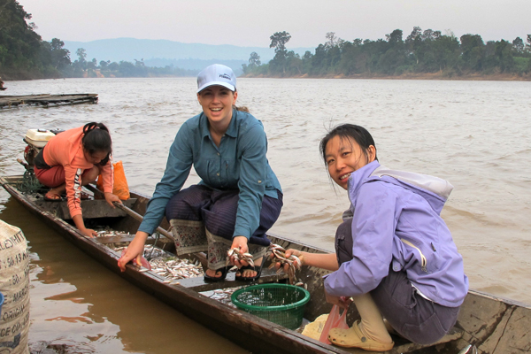 Harmony Patricio (center) taking fish samples in the Mekong River. Photo courtesy of FISHBIO.