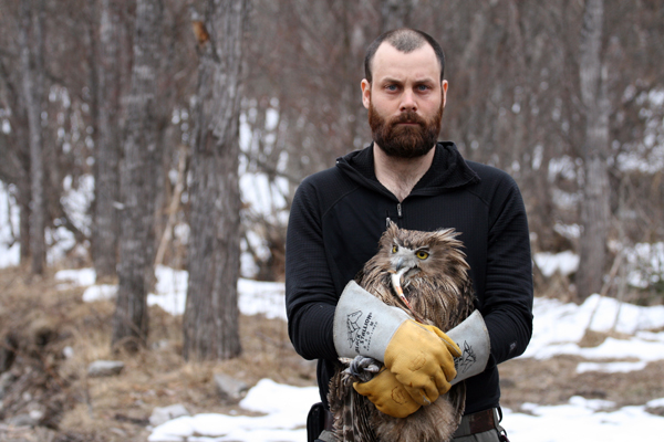 Jonathan Slaght with a Blakiston's fish owl. Photograph courtesy Sergei Avdeyuk, Amur-Ussuri Center for Avian Bioiversity.
