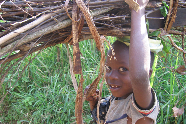 Boy carrying wood. Photo courtesy of New Nature Foundation.