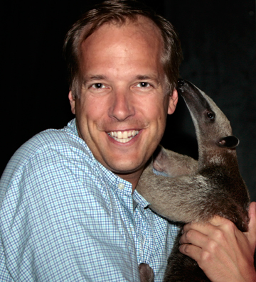 Jeff Flocken with tamandua. Photo courtesy of Jeff Flocken.