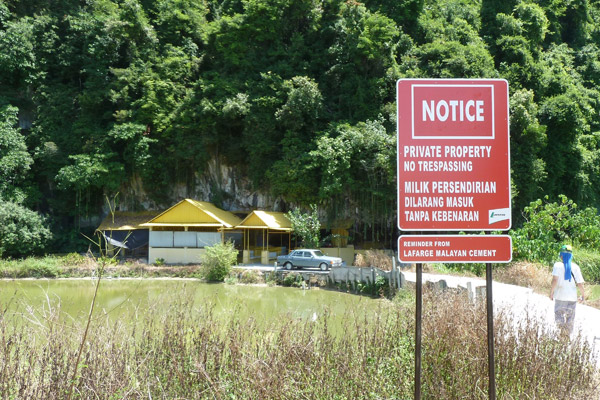 'No trespassing' sign placed by Lafarge on the way to the Chinese temple in the base of Kanthan hill. Photo by: Liz Price.