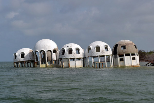 Climate change is rapidly raising sea levels in Southern Florida. Here dome houses lie submerged that were once a quarter mile from the beach. Photo courtesy of Gary Schmelz.