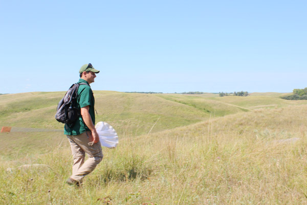 Erik Runquist looking for butterflies in Glacial Lakes State Park, Minnesota. This is one of the places where Poweshieks have disappeared recently. Photo courtesy of Erik Runquist.