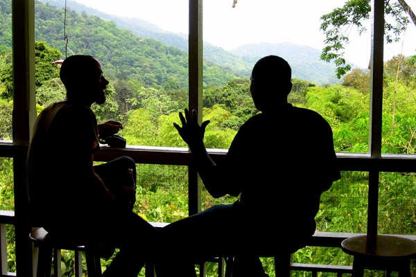 Tourist and guide enjoying the birding on the veranda of the Asa Wright Nature Center in Trinidad. Photo by Tiffany Roufs.