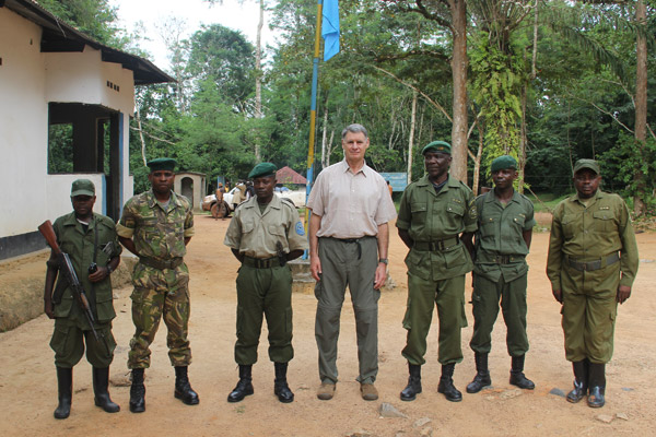 John Lukas (center) with wildlife rangers at the headquarters in Epulu. Photo courtesy of the Okapi Conservation Project.