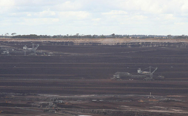 Massive open cut brown coal mine in Victoria, Australia. Over 80 percent of Australia's energy is powered by coal, the world most carbon-intensive fuel source. Australia also exports over half the coal it mines. Photo by: Marcus Wong Wongm.