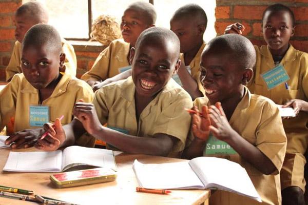 Rwandan children participating in AoC activities. Photo: © Julie Ghrist.
