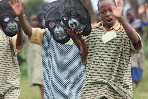 Children preparing for performances. Gorilla animal masks made at AoC studio by AoC teachers Eric Mutabazi and Eusebe Mwizerwa. Photo: © Julie Ghrist.